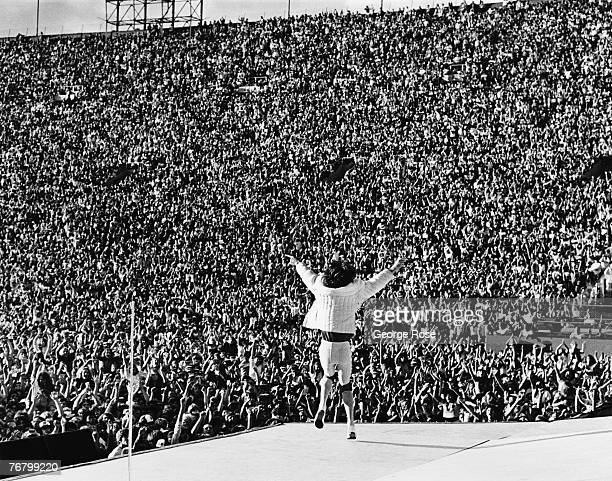 Mick Jagger lead singer of the British rock band The Rolling Stones prances on stage in front of 100000 people during a 1981 Los Angeles California...