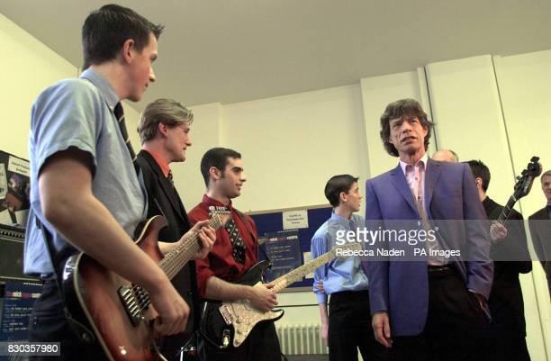 Mick Jagger meets members of the school band 'Cherry Sunburst' in the new music studio at Dartford Grammar school Kent The Rolling Stones rock...