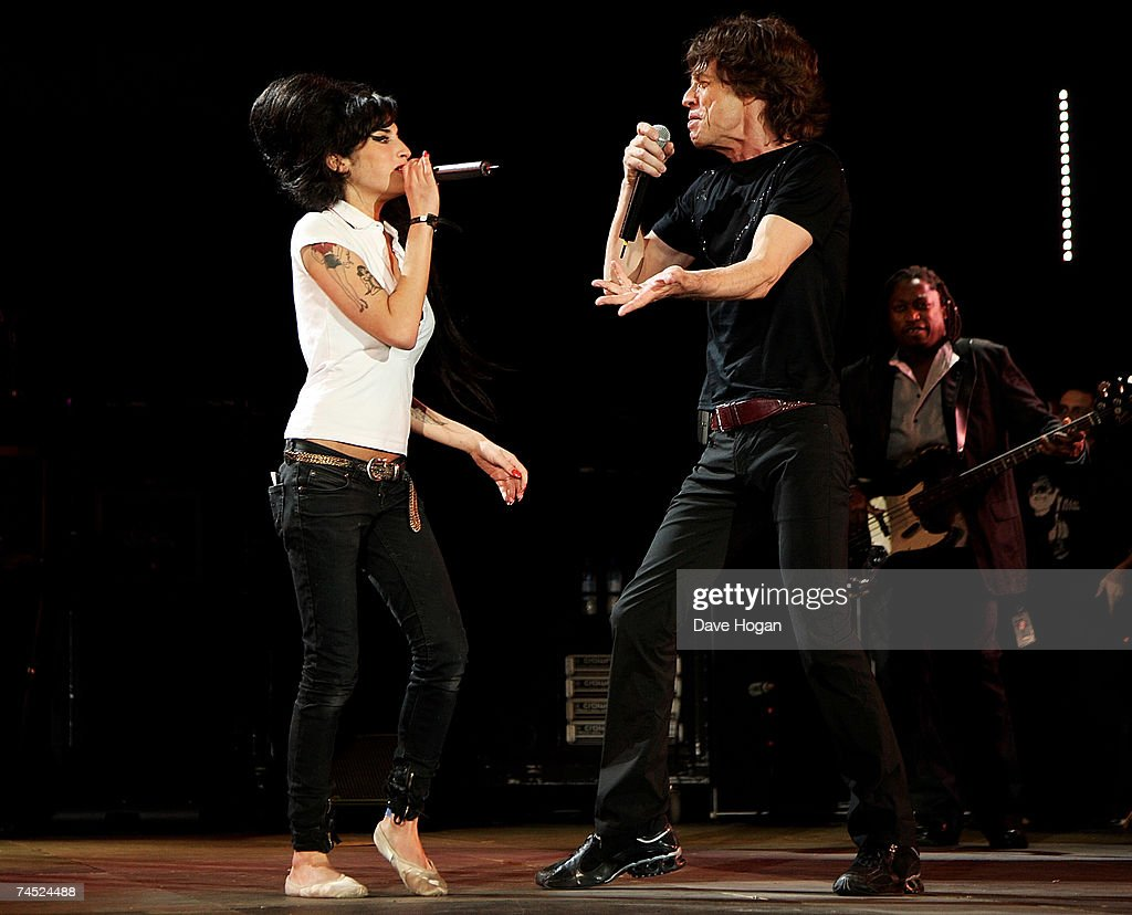 <a gi-track='captionPersonalityLinkClicked' href=/galleries/search?phrase=Mick+Jagger&family=editorial&specificpeople=201786 ng-click='$event.stopPropagation()'>Mick Jagger</a> of the Rolling Stones and <a gi-track='captionPersonalityLinkClicked' href=/galleries/search?phrase=Amy+Winehouse&family=editorial&specificpeople=201684 ng-click='$event.stopPropagation()'>Amy Winehouse</a> perform on stage on the final day of the Isle of Wight Festival 2007 in Newport on June 10, 2007 on the Isle of Wight, England.