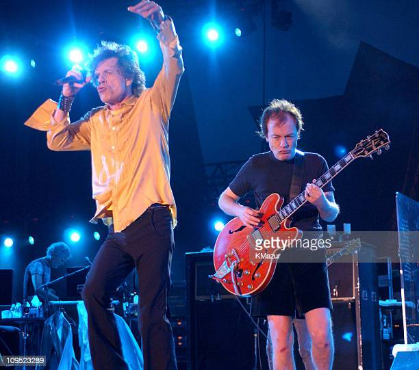 Mick Jagger of The Rolling Stones and Angus Young of AC/DC