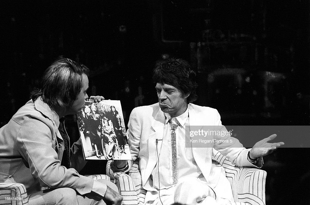 Mick Jagger of the Rolling Stones and comedian Dan Aykroyd are photographed on the set of Saturday Night Live on October 7, 1978 in New York City.