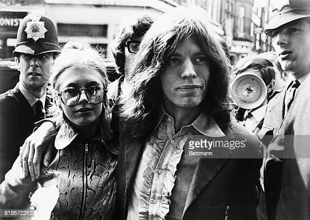 Mick Jagger of the Rolling Stones and girlfriend singer Marianne Fiathfull arrive at Magistrate's Court early May 29 to face charges of possessing...