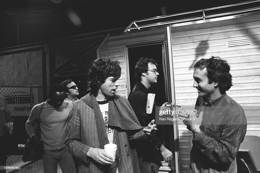 Mick Jagger of The Rolling Stones, comedians Garrett Morris, John Belushi, Dan Ackroyd and Loren Michaels are photographed on the set of Saturday Night Live on October 7, 1978 in New York City.