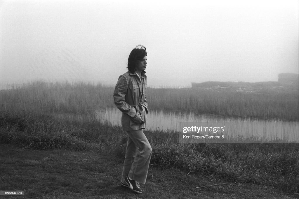 Mick Jagger of the Rolling Stones is photographed at artist Andy Warhol's home in 1975 in Montauk, New York.