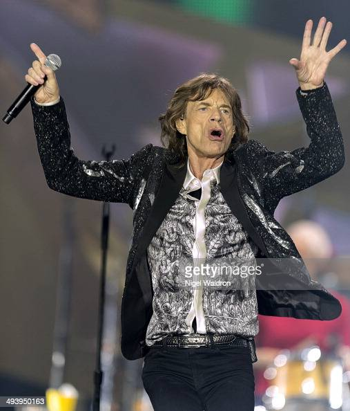 Mick Jagger of The Rolling Stones performs on stage at Telenor Arena during the On Fire Tour 2014 on May 26 2014 in Oslo Norway