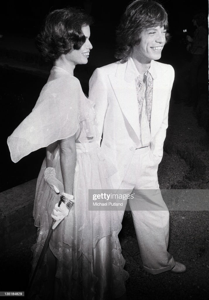 Mick Jagger of the Rolling Stones with his wife Bianca at a promotional party for the band's album Goats Head Soup, Blenheim Palace, Oxfordshire, 6th September 1973.