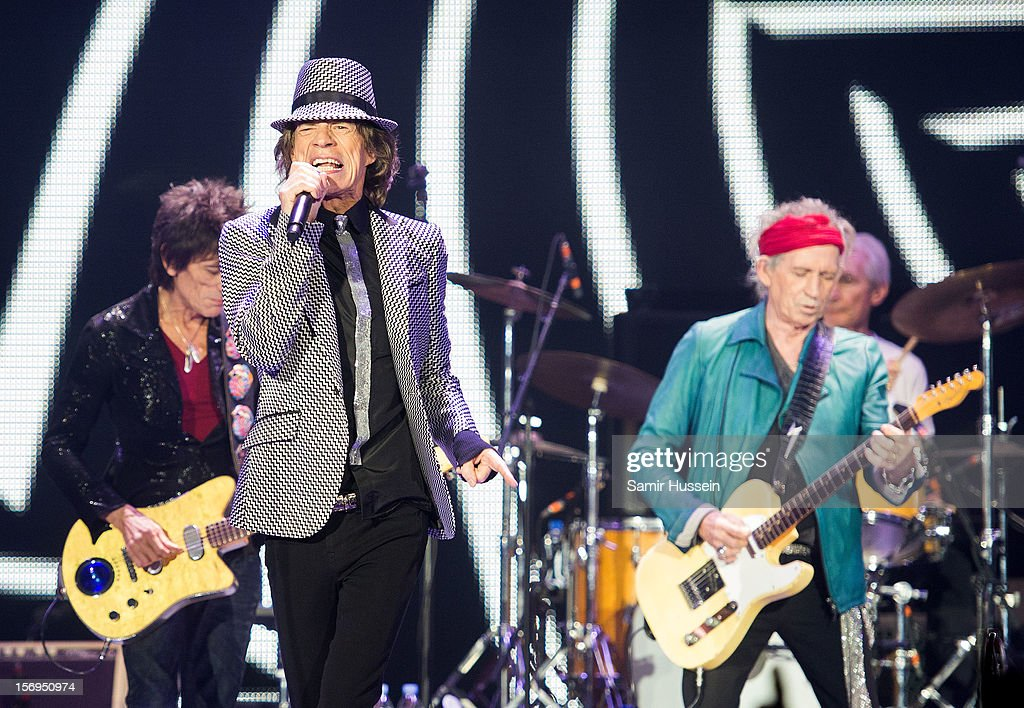 Mick Jagger, Ronnie Wood (L), and Keith Richards of The Rolling Stones perform live on stage at the first of their 50th Anniversary concerts at the O2 Arena on November 25, 2012 in London, England.