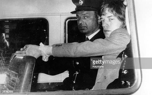 Mick Jagger singer of British pop group the Rolling Stones is driven to Brixton prison to begin a three month sentence for drug offences