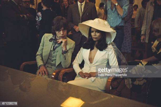 Mick Jagger singer with The Rolling Stones pictured together with Bianca PerezMora Macias at their civic wedding ceremony in Saint Tropez France on...