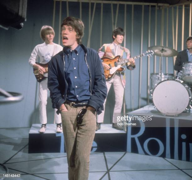 Mick Jagger sings with British pop group the Rolling Stones on a television show 1st October 1965 Behind him are from left to right Brian Jones Keith...