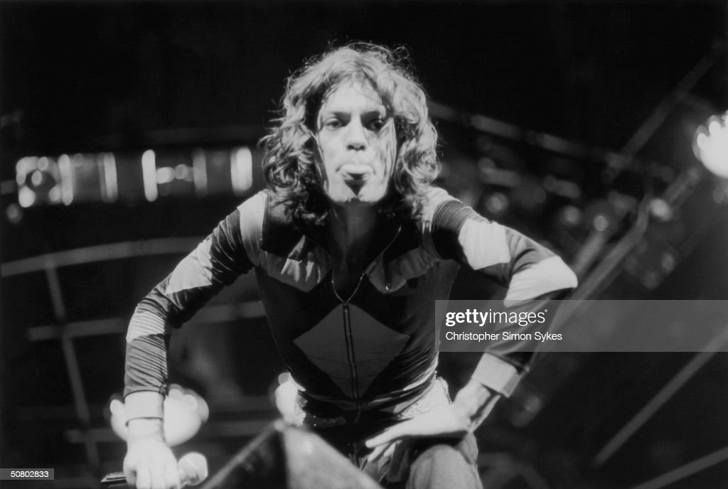 Mick Jagger sticks out his tongue during a concert on the Rolling Stones' 1975 Tour of the Americas.