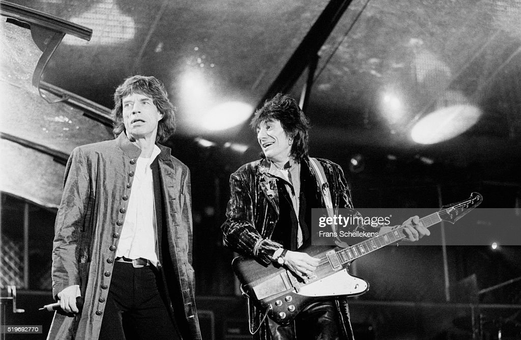 Mick Jagger vocals and Ron Wood guitar perform with Rolling Stones on August 30st 1995 at the Feijenoord Stadium in Rotterdam Netherlands