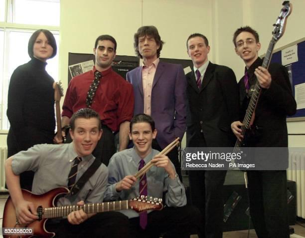 Mick Jagger with members of the school band 'Cherry Sunburst' in the new music studio at Dartford Grammar school Kent The Rolling Stones rock veteran...
