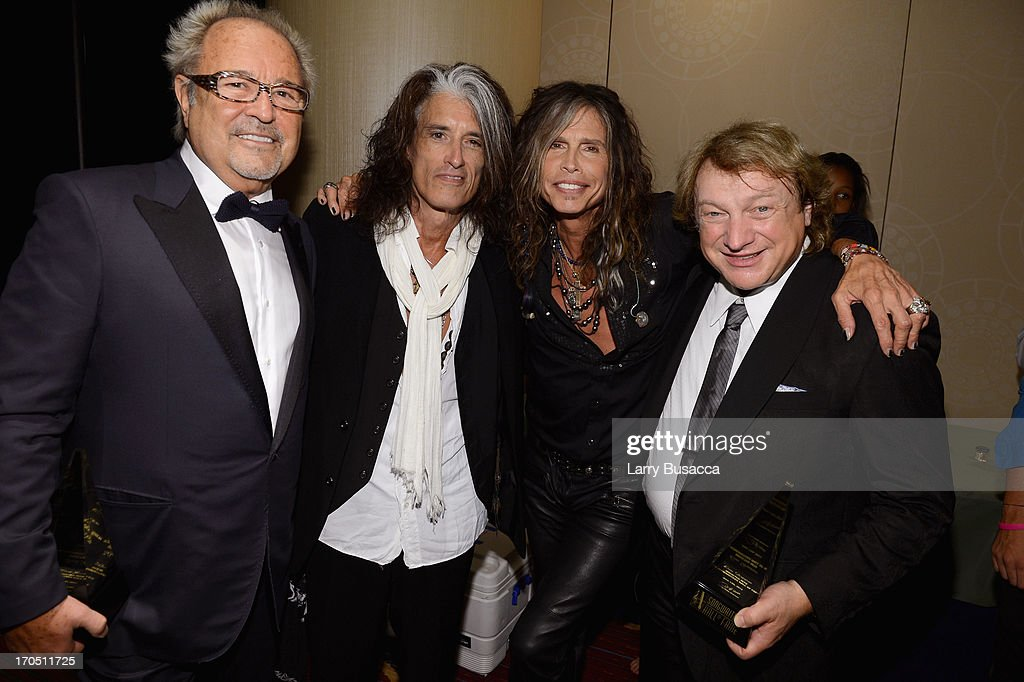 Mick Jones and Lou Gramm of Foreigner pose with Joe Perry and Steven Tyler at the Songwriters Hall of Fame 44th Annual Induction and Awards Dinner at the New York Marriott Marquis on June 13, 2013 in New York City.