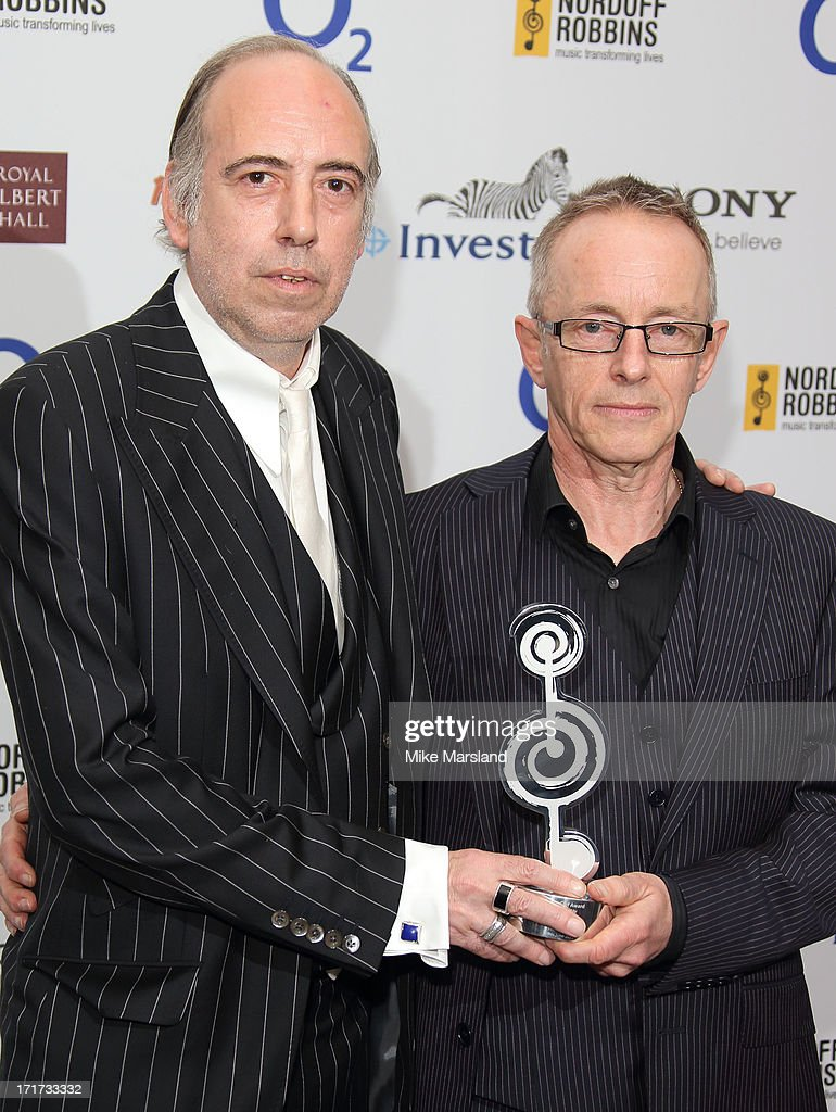 <a gi-track='captionPersonalityLinkClicked' href=/galleries/search?phrase=Mick+Jones+-+Musician+-+The+Clash&family=editorial&specificpeople=212985 ng-click='$event.stopPropagation()'>Mick Jones</a> and Nick Headon attend the Nordoff Robbins Silver Clef Awards at London Hilton on June 28, 2013 in London, England.