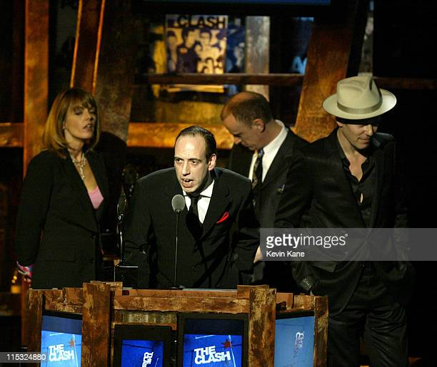 Mick Jones at the podium with Lucinda Strummer Terry Chimes and Paul Simonon