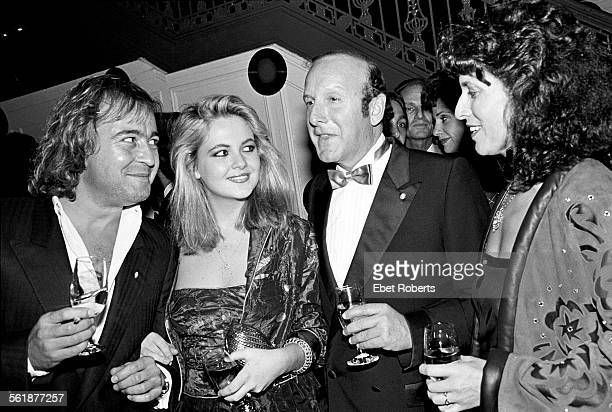 Mick Jones of Foreigner and his wife Ann DexterJones with record producer and music industry executive Clive Davis and friend attending an A Flock Of...