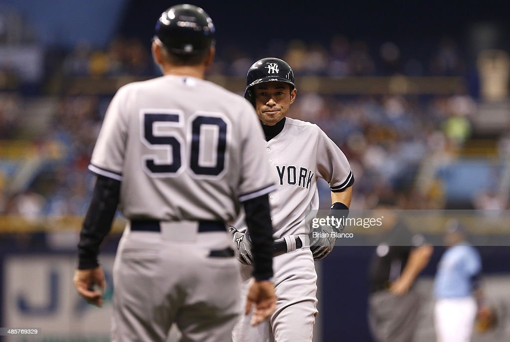 Mick Kelleher #50 of the New York Yankees looks on as Ichiro Suzuki #31 of the New York Yankees comes in to pinch run for Derek Jeter during the 11th inning of a game against the Tampa Bay Rays on April 20, 2014 at Tropicana Field in St. Petersburg, Florida.