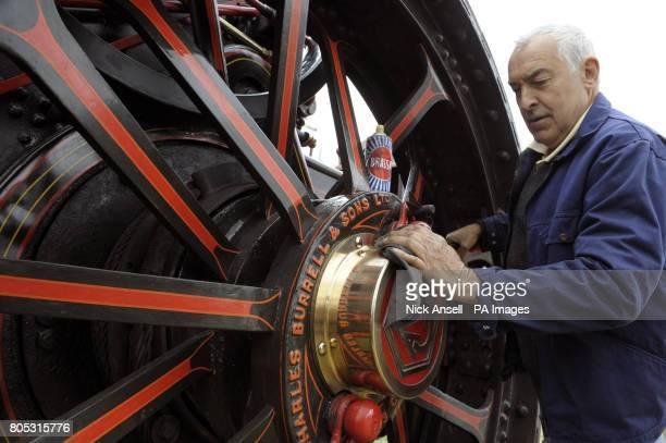 Mick Kettle of Billericay polishes a hub cap of a 1921 built Burrell 8nhp general purpose agricultural engine at Barleylands Steam Fair Barleylands...