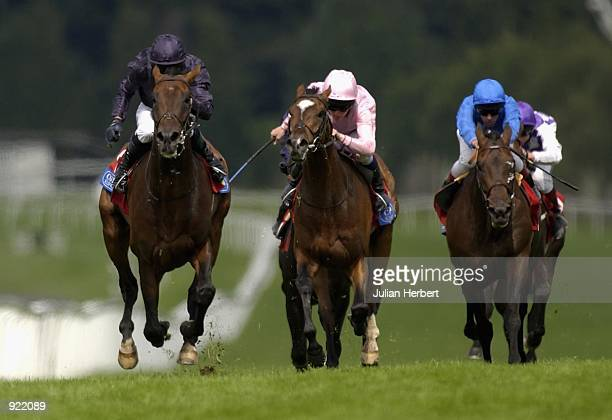 Mick Kinane and Hawk Wing lead the field home to land The Coral Eclipse Stakes run at Sandown Racecourse in Esher on July 06 2002