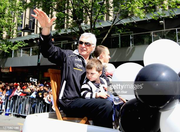 Mick Malthouse coach of the Magpies waves to the fans during the AFL Grand Final parade on September 30 2011 in Melbourne Australia