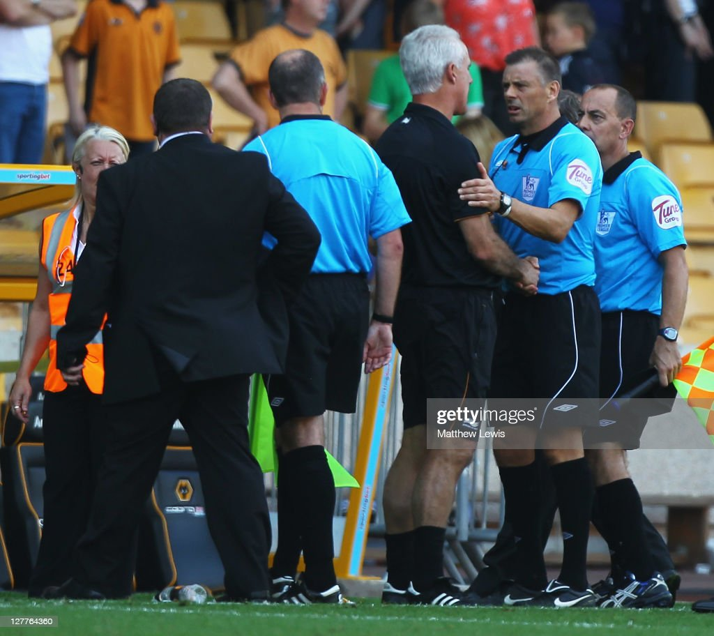 <a gi-track='captionPersonalityLinkClicked' href=/galleries/search?phrase=Mick+McCarthy&family=editorial&specificpeople=226594 ng-click='$event.stopPropagation()'>Mick McCarthy</a>, manager of Wolverhampton Wanderers talks to Referee <a gi-track='captionPersonalityLinkClicked' href=/galleries/search?phrase=Mark+Halsey&family=editorial&specificpeople=224397 ng-click='$event.stopPropagation()'>Mark Halsey</a> after the Barclays Premier League match between Wolverhampton Wanderers and Newcastle United at Molineux on October 1, 2011 in Wolverhampton, England.