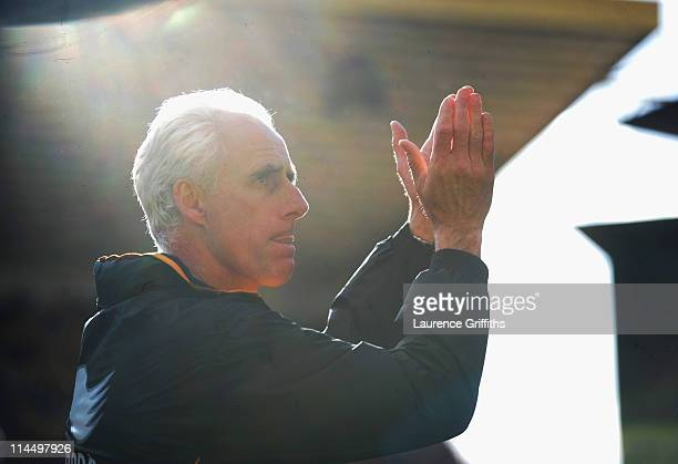 Mick McCarthy of Wolverhampton Wanderers applauds the fans after avoiding relegation during the Barclays Premier League match between Wolverhampton...