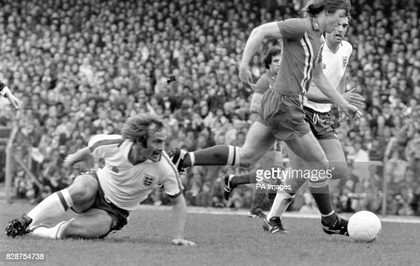 Mick Mills the man who captained Ipswich in their FA Cup win over Arsenal sits this one out at Ninian Park as he watches England team mate Trevor...