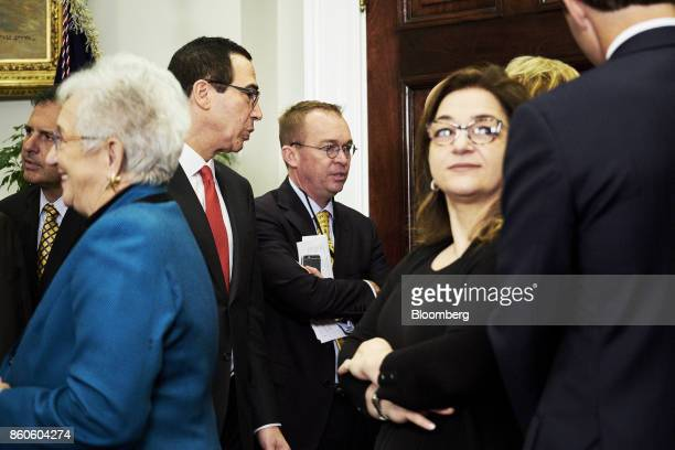 Mick Mulvaney director of the Office of Management and Budget center speaks with Steven Mnuchin US Treasury secretary left before US President Donald...