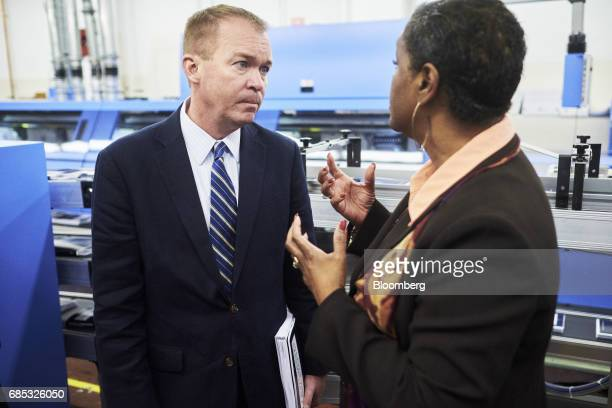 Mick Mulvaney director of the US Office of Management and Budget left speaks with Davita VanceCooks director of the Government Publishing Office...