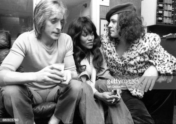 Mick Ronson Gloria Jones and Marc Bolan share a sofa in the control room at Air Studios Oxford Street London 1974 during the recording of the first...