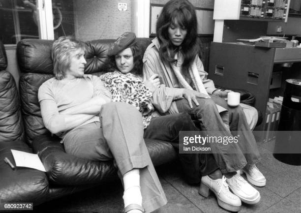 Mick Ronson Marc Bolan and Gloria Jones share a sofa in the control room at Air Studios Oxford Street London 1974 during the recording of the first...