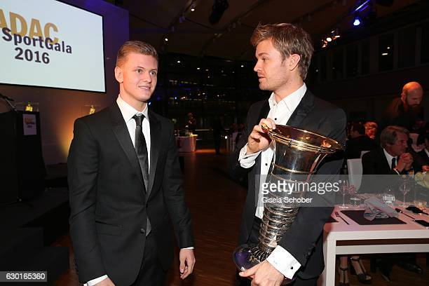 Mick Schumacher F4 driver and son of Michael Schumacher and Nico Rosberg Formula One F1 driver and World Champion 2016 with trophy during the ADAC...