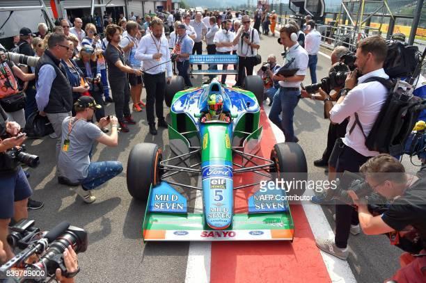 TOPSHOT Mick Schumacher German racing driver and son of seventime Formula One champion Michael Schumacher sits inside a Benetton B194 car before...