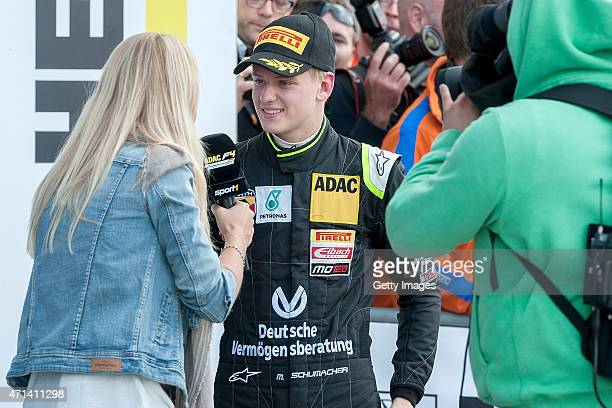 Mick Schumacher talks to the media after winning race three of the ADAC Formula Four championship at Motorsport Arena Oschersleben on April 25 2015...