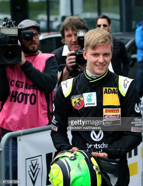 Mick Schumacher the son of former Formula 1 driver Michael Schumacher smiles after winning celebrates after winning the trophy for the best rookie...
