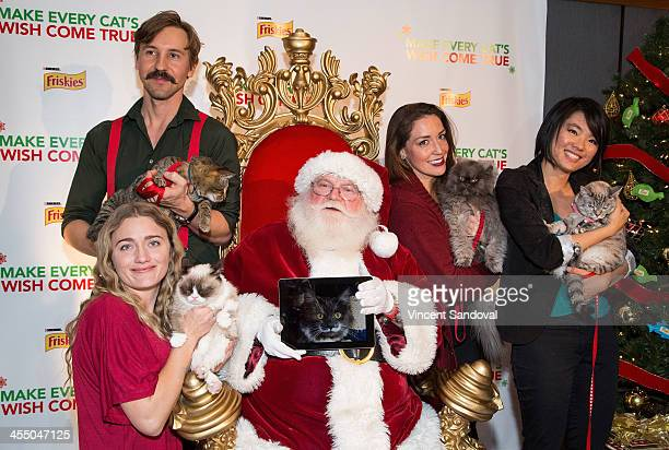 Mick Szydlowski holding his cat Oskar Tabatha Bundesen holding Grumpy Cat 'Santa Claus' holding a picture of Hamilton The Hipster Cat Anne Marie Avey...