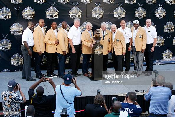 Mick Tingelhoff poses with his bust along with several of his former teammates during the NFL Hall of Fame induction ceremony at Tom Benson Hall of...