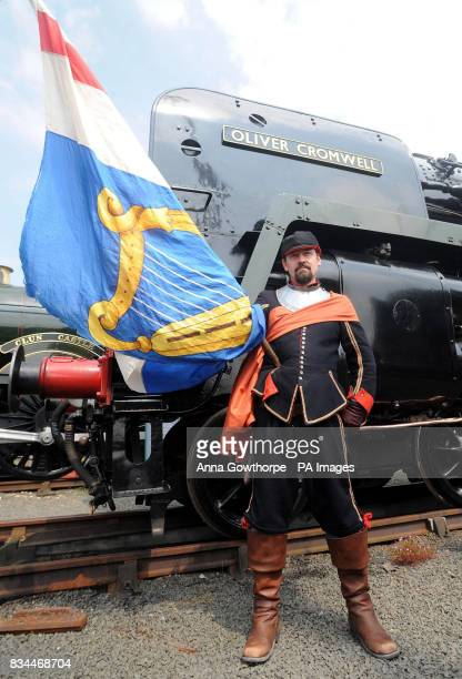 Mick Wokes from the Civil War Society carries the Commonwealth Colour during a nine day celebration which started today to mark the return of the...