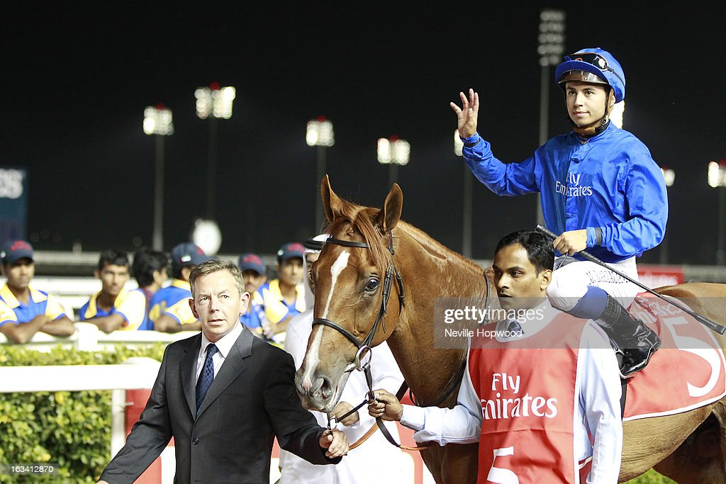 Mickael Barzalona rides African Story (Blue Silks, blue cap) in race 6, the 8f Group 3 Burj Nahaar race and is led into the winners circle by Godolphin's Saeed Bin Suroor's travelling head lad, <a gi-track='captionPersonalityLinkClicked' href=/galleries/search?phrase=Tommy+Burns&family=editorial&specificpeople=849163 ng-click='$event.stopPropagation()'>Tommy Burns</a>, during Super Saturday at Meydan Racecourse on March 9, 2013 in Dubai, United Arab Emirates.