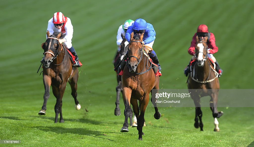 Mickael Barzalona riding Solidarity (blue) win The British Stallion Studs EBF Maiden Stakes at Epsom racecourse on August 27, 2013 in Epsom, England.