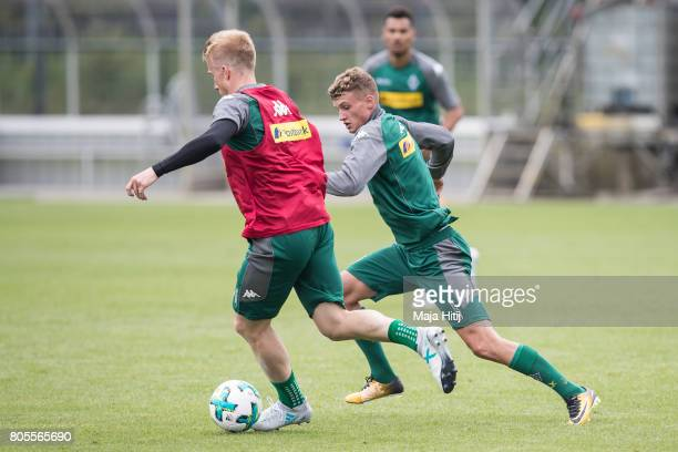 Mickael Cuisance and Oscar Wendt of Moenchengladbach ballte for the ball during Training Session on July 2 2017 in Moenchengladbach Germany