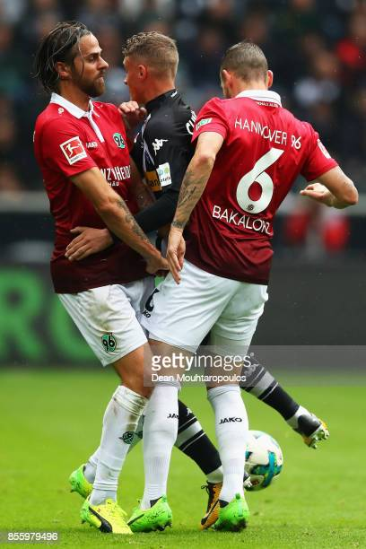Mickael Cuisance of Borussia Monchengladbach battles for the ball with Martin Harnik and Marvin Bakalorz of Hannover 96 during the Bundesliga match...