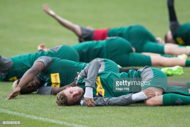 Mickael Cuisance of Moenchengladbach stretches during Training Session on July 2 2017 in Moenchengladbach Germany
