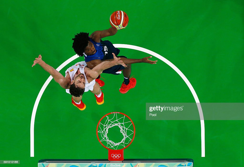 Mickael Gelabale #15 of France goes to the basket against Pau Gasol #4 of Spain during the Men's Quarterfinal match on Day 12 of the Rio 2016 Olympic Games at Carioca Arena 1 on August 17, 2016 in Rio de Janeiro, Brazil.