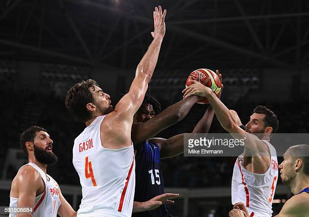 Mickael Gelabale of France goes to the basket under pressure against Pau Gasol and Rudy Fernandez of Spain during the Men's Quarterfinal match on Day...