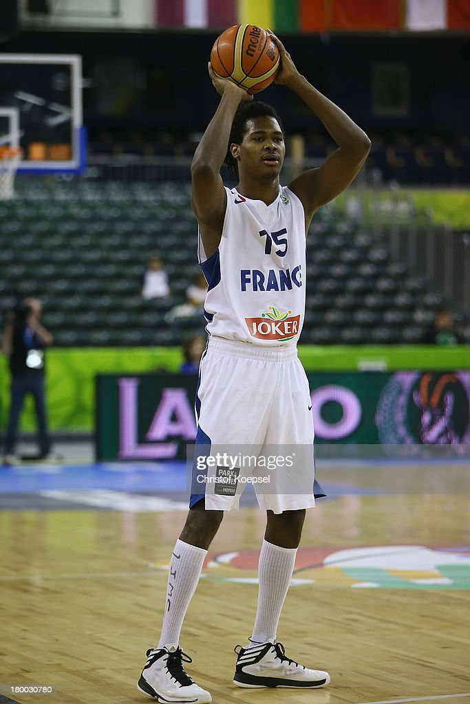<a gi-track='captionPersonalityLinkClicked' href=/galleries/search?phrase=Mickael+Gelabale&family=editorial&specificpeople=700549 ng-click='$event.stopPropagation()'>Mickael Gelabale</a> of France leads the ball during the FIBA European Championships 2013 first round group A match between France and Israel at Tivoli Arena on September 6, 2013 in Ljubljana, Slovenia.