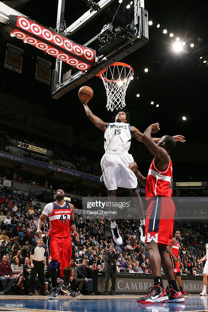 Mickael Gelabale #15 of the Minnesota Timberwolves dunks against Emeka Okafor #50 of the Washington Wizards on March 6, 2013 at Target Center in Minneapolis, Minnesota.
