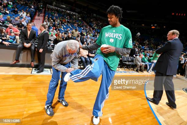 Mickael Gelabale of the Minnesota Timberwolves has his sneaker signed before playing against the New Orleans Hornets on March 17 2013 at Target...