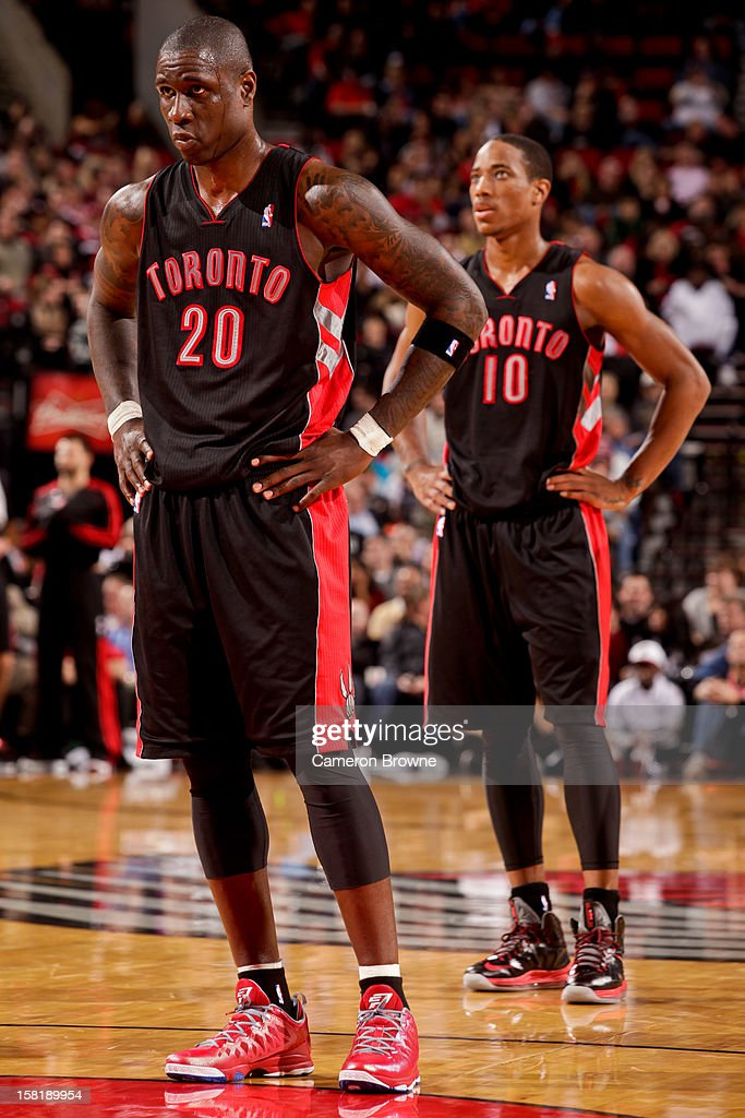 <a gi-track='captionPersonalityLinkClicked' href=/galleries/search?phrase=Mickael+Pietrus&family=editorial&specificpeople=202910 ng-click='$event.stopPropagation()'>Mickael Pietrus</a> #20 and DeMar DeRozan #10 of the Toronto Raptors wait to resume action against the Portland Trail Blazers on December 10, 2012 at the Rose Garden Arena in Portland, Oregon.